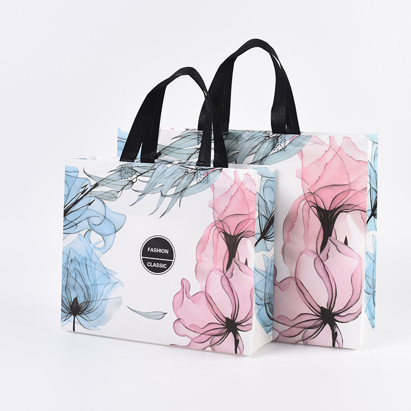 Creative non-woven clothing shopping bags in stock advertising promotional gift bags laminated non-w