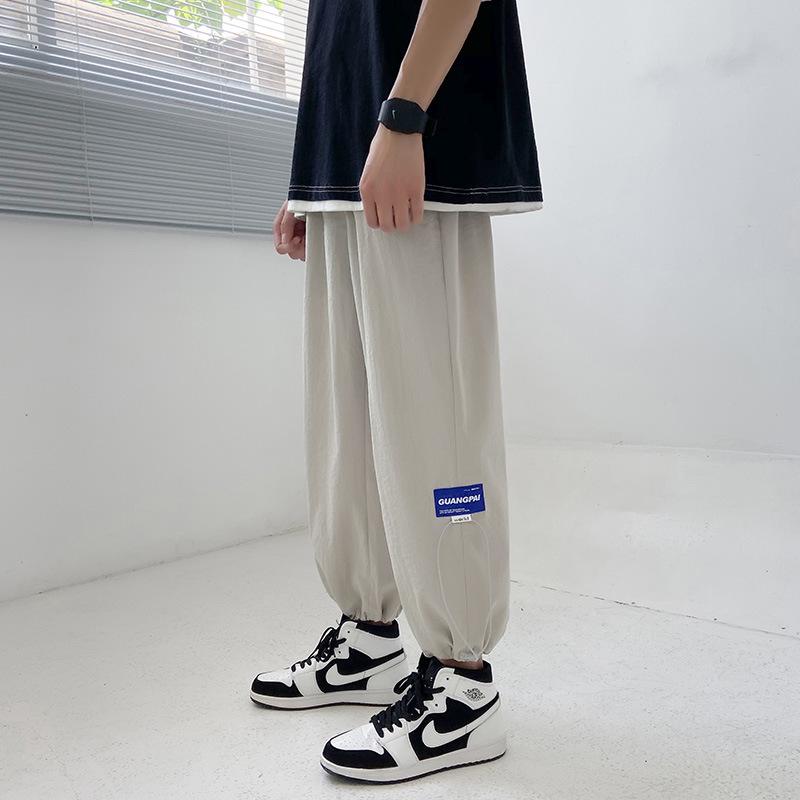 Summer thin pants men's ice silk pants Korean trend casual pants loose nine-point sports pants tie-